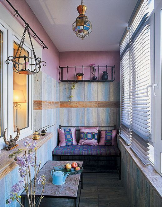 Cozy vintage design of the small seating place at the balcony