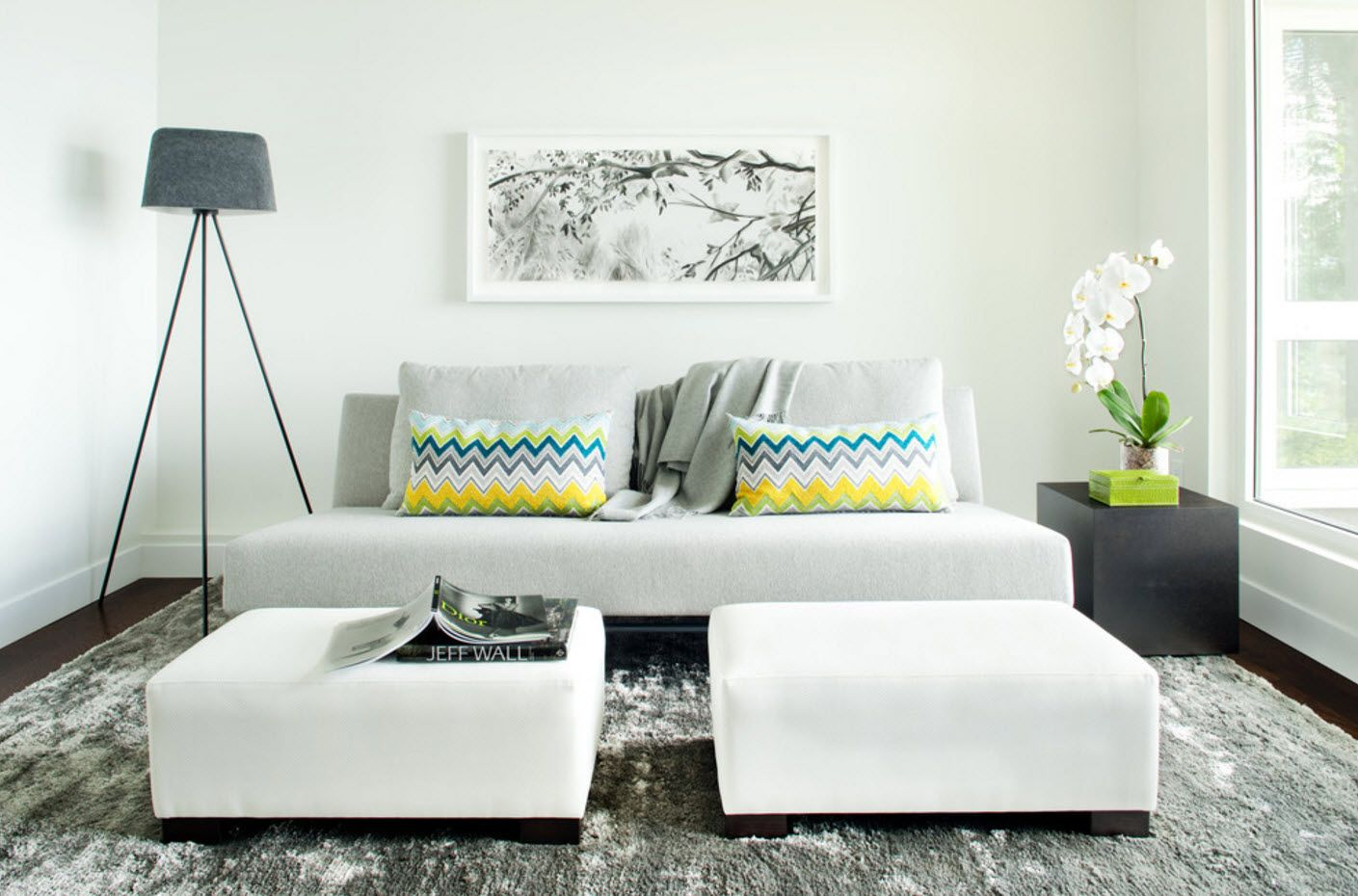 Living room with gray cushions at the sofa and two white upholstered coffe tables
