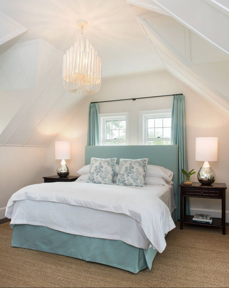 Rustic French style with turquoise coloring and slanted loft ceiling