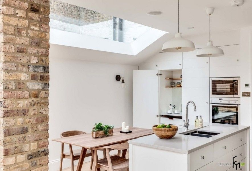 Modern English Country Style Interior Design Example. Bent tap and glossy worktop of the kitchen island