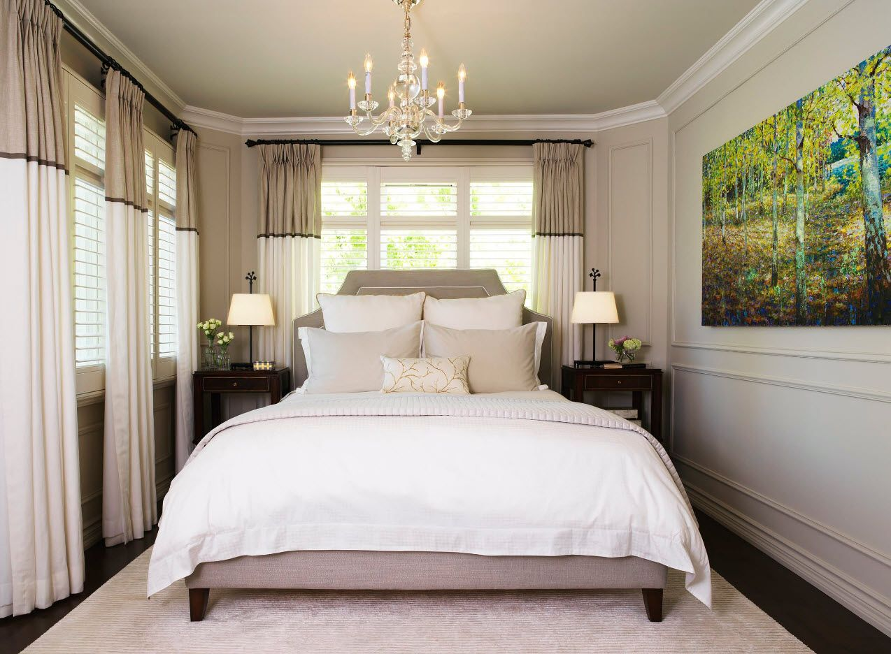 White bed as an accent in the gray and pastel colored bedroom with large canvas picture