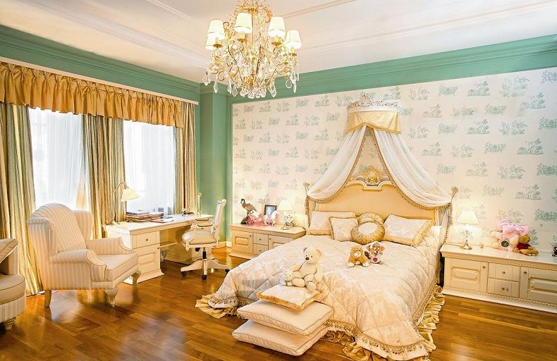 Royal bed with tulle crowned headboard and golden silk pillows at the other side. Empire style