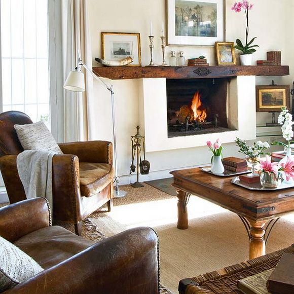 Noble look of wooden furniture and pompous fireplace at the country mansion