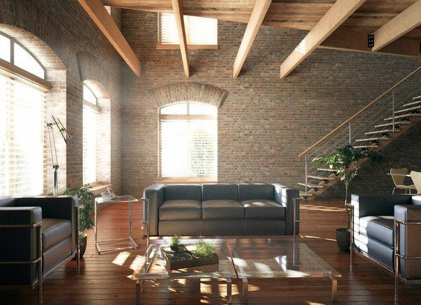 Two-level apartment with apparent brickwork walls in loft style