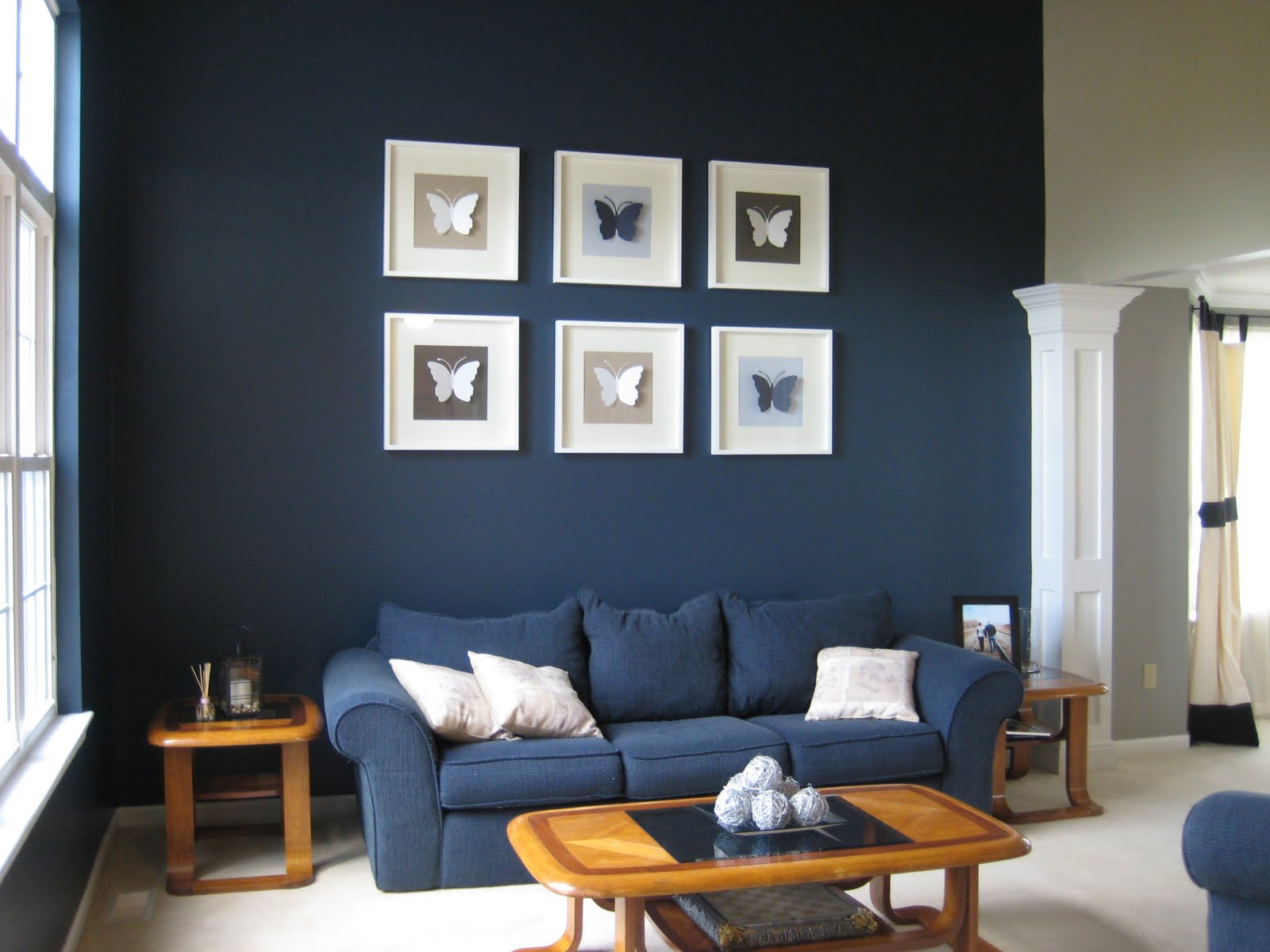 Deep blue accent wall with pictures