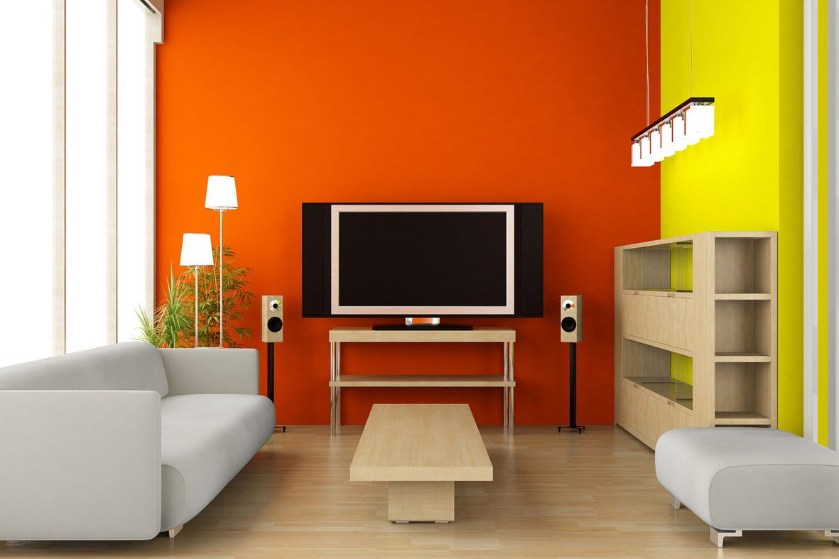 Orange accentual wall in the living room with big tv-set