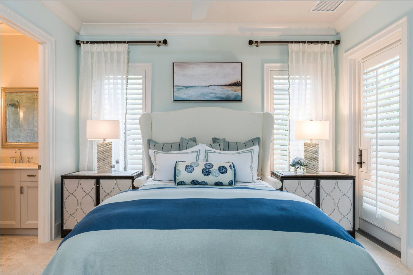 Marine style in the cottage bedroom with translucent tulle at the windows