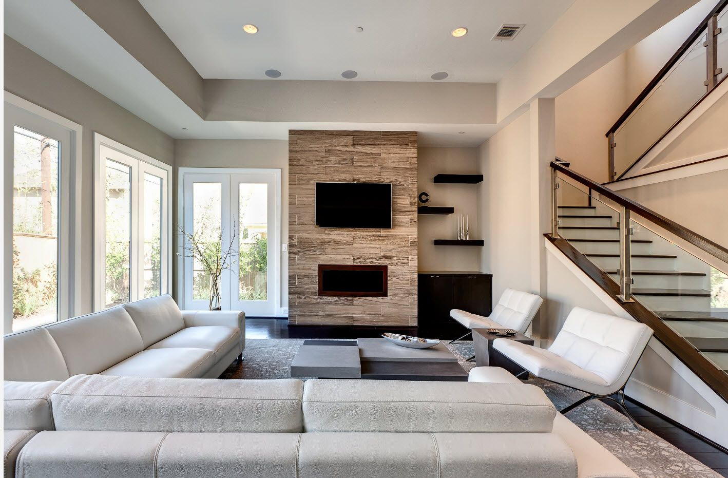 Modern design of the living room in the private house with textured accent wall in light brown color