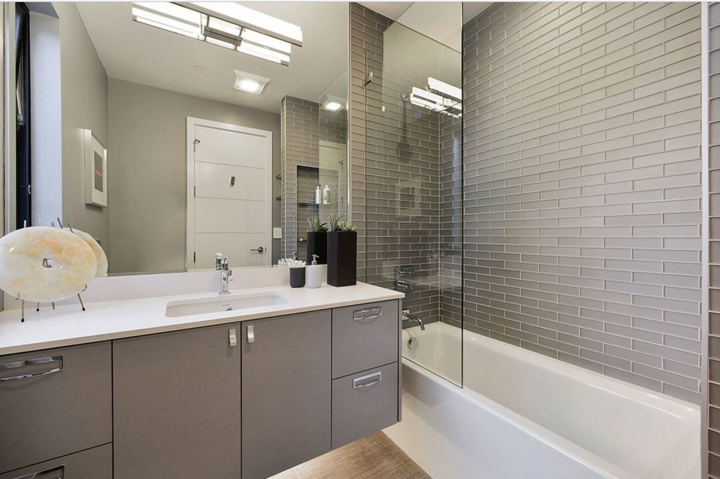 Spectacular modern set in the cottage's bathroom in grey tones and mosaic tile