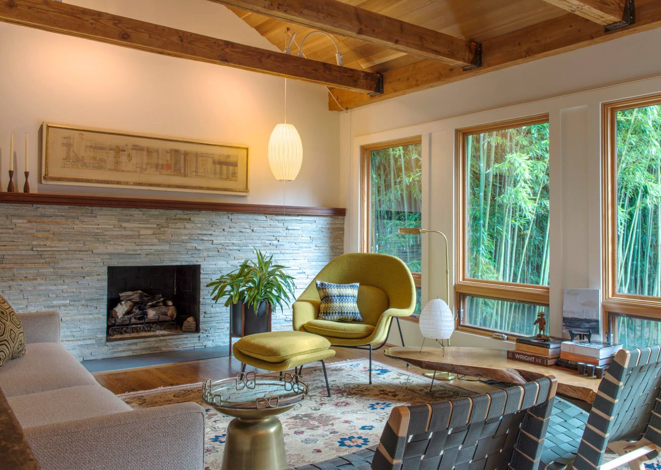 Open living room layout of the cottage with noble oak ceiling beams