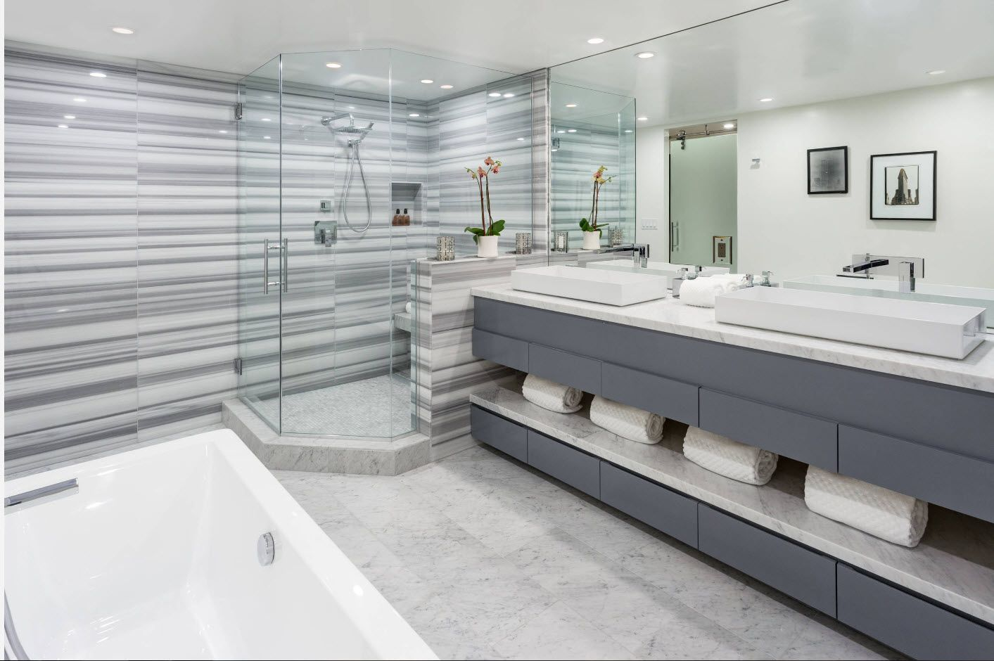 Gorgeous large bathroom with marble streaked wall design and nobke gray modular vanity