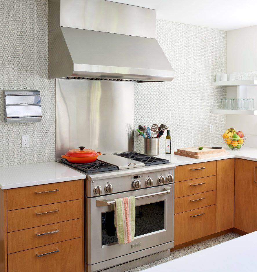Wooden kitchen set surfaces and steel metal shine