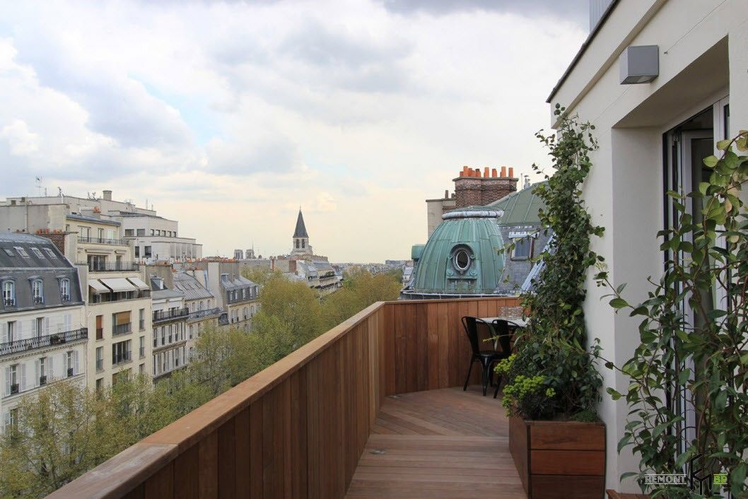 French Interior Traditions in Modern Apartment Interpretation. Panoramic terrace with wooden fencing