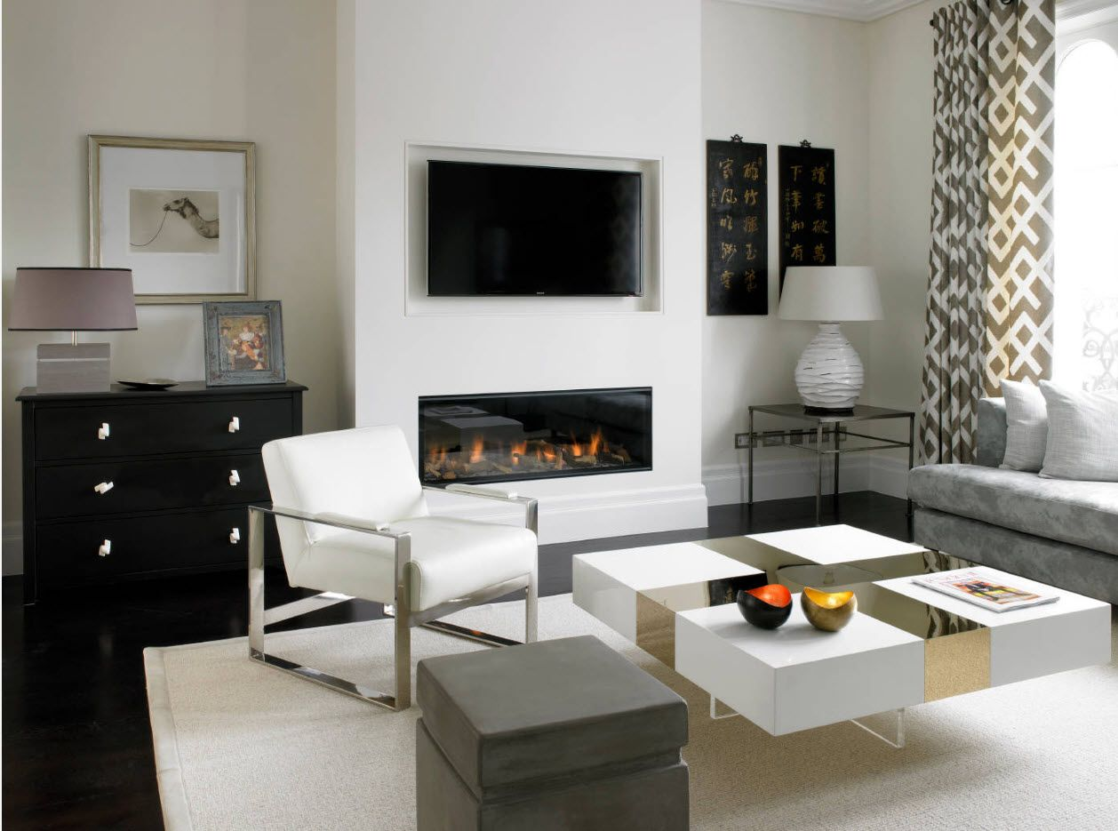 White desogn for the modern living room with the touch of Scandinavian motifs, fireplace, TV-set and airy coffee table