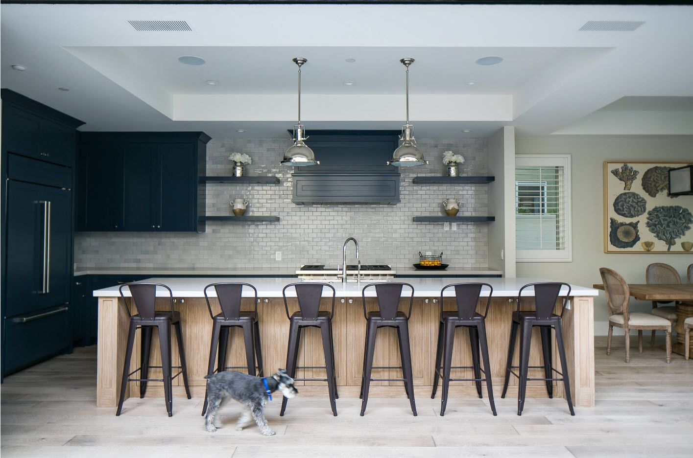 A set of bar stools at the dining zone of modern kitchen with dining zone