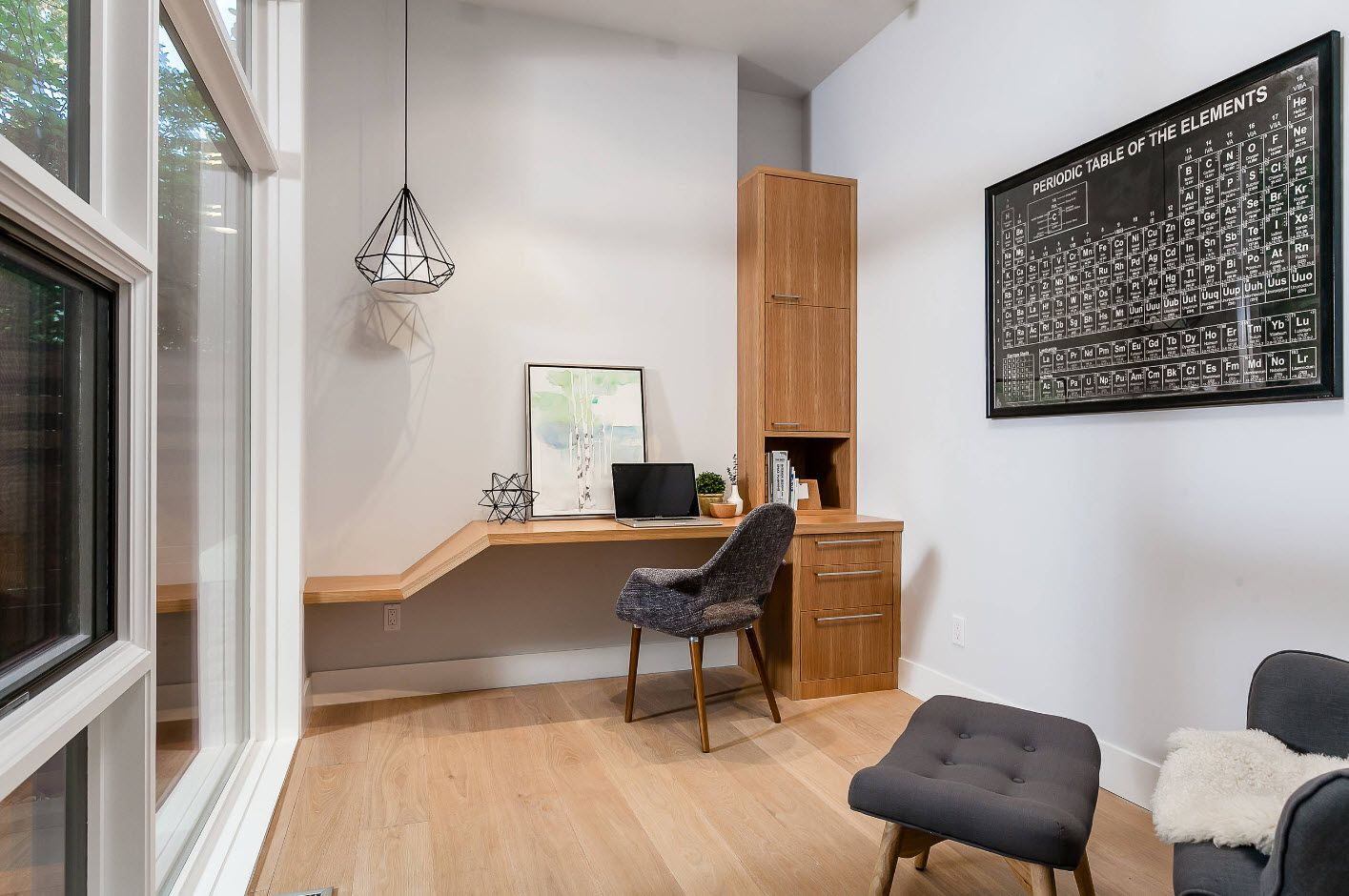 Light wooden furniture and wavy working top at the minimalsitic home office