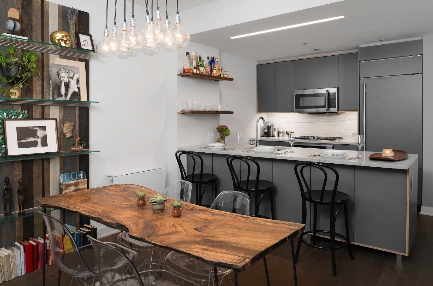 Kitchen wiiden table and linear layout and large raw wooden table in the center