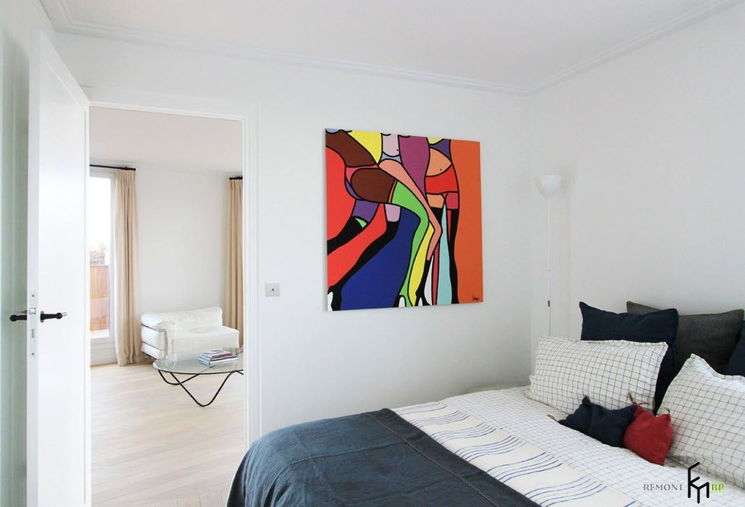 French Interior Traditions in Modern Apartment Interpretation. Bright colorful picture on the wall