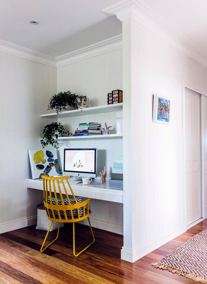 Yellow framed chair for the minimalstic design of the working place