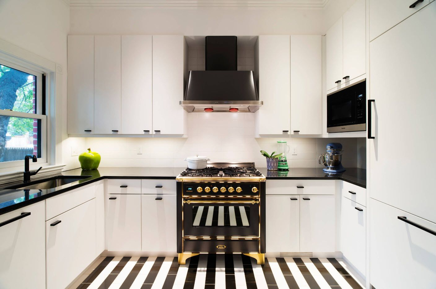 Black and white striped tiled floor at the hi-tech cottage kitchen