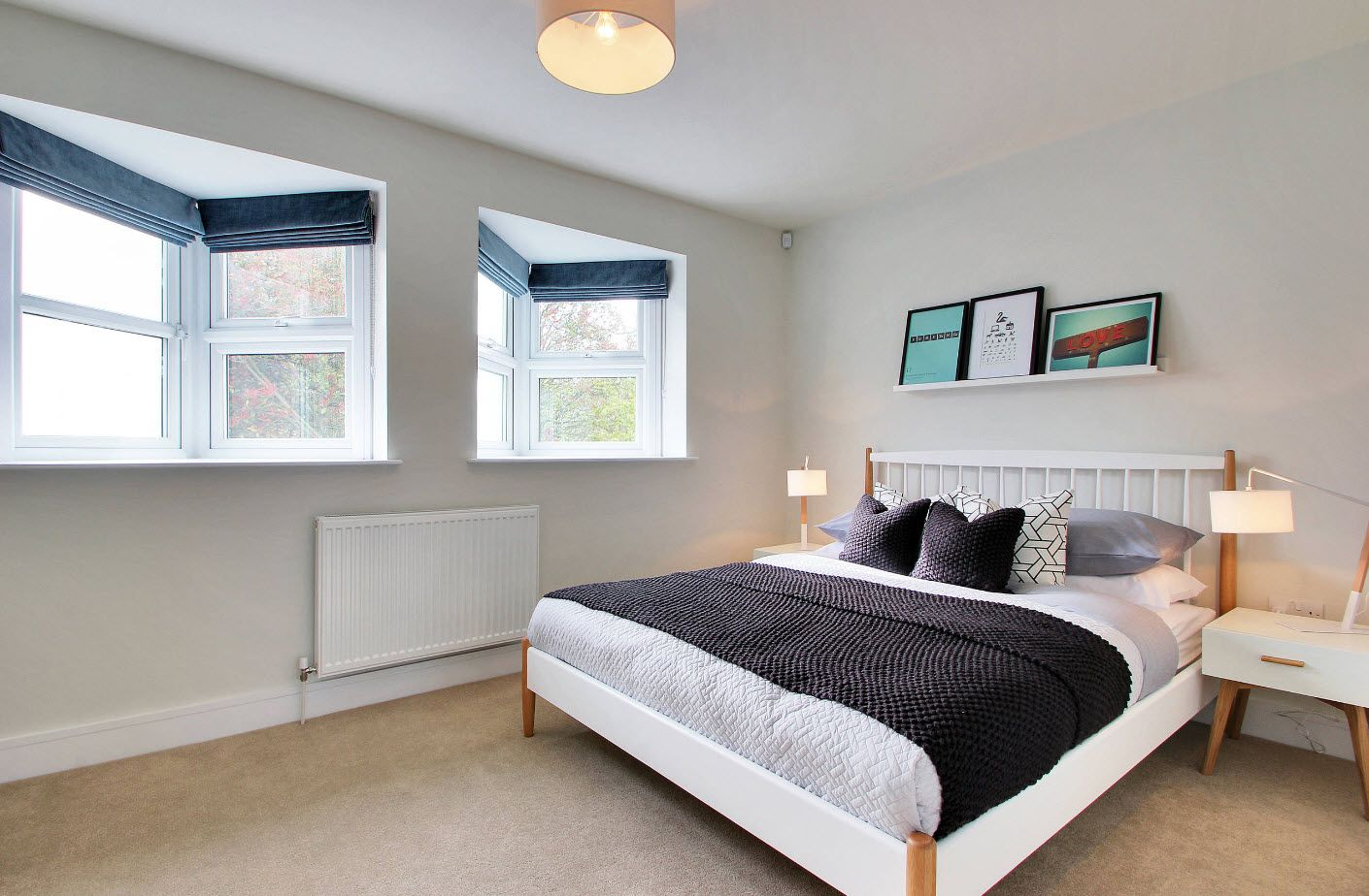 Nice bay window design for unusual architecture of the cottage's bedroom