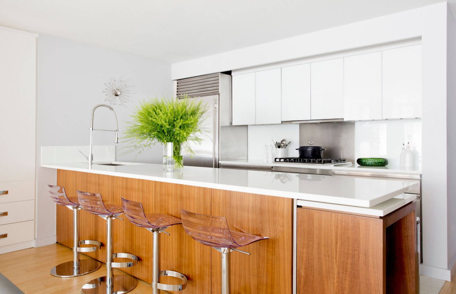Gorgeous large kitchen with light wooden board of the kitchen island