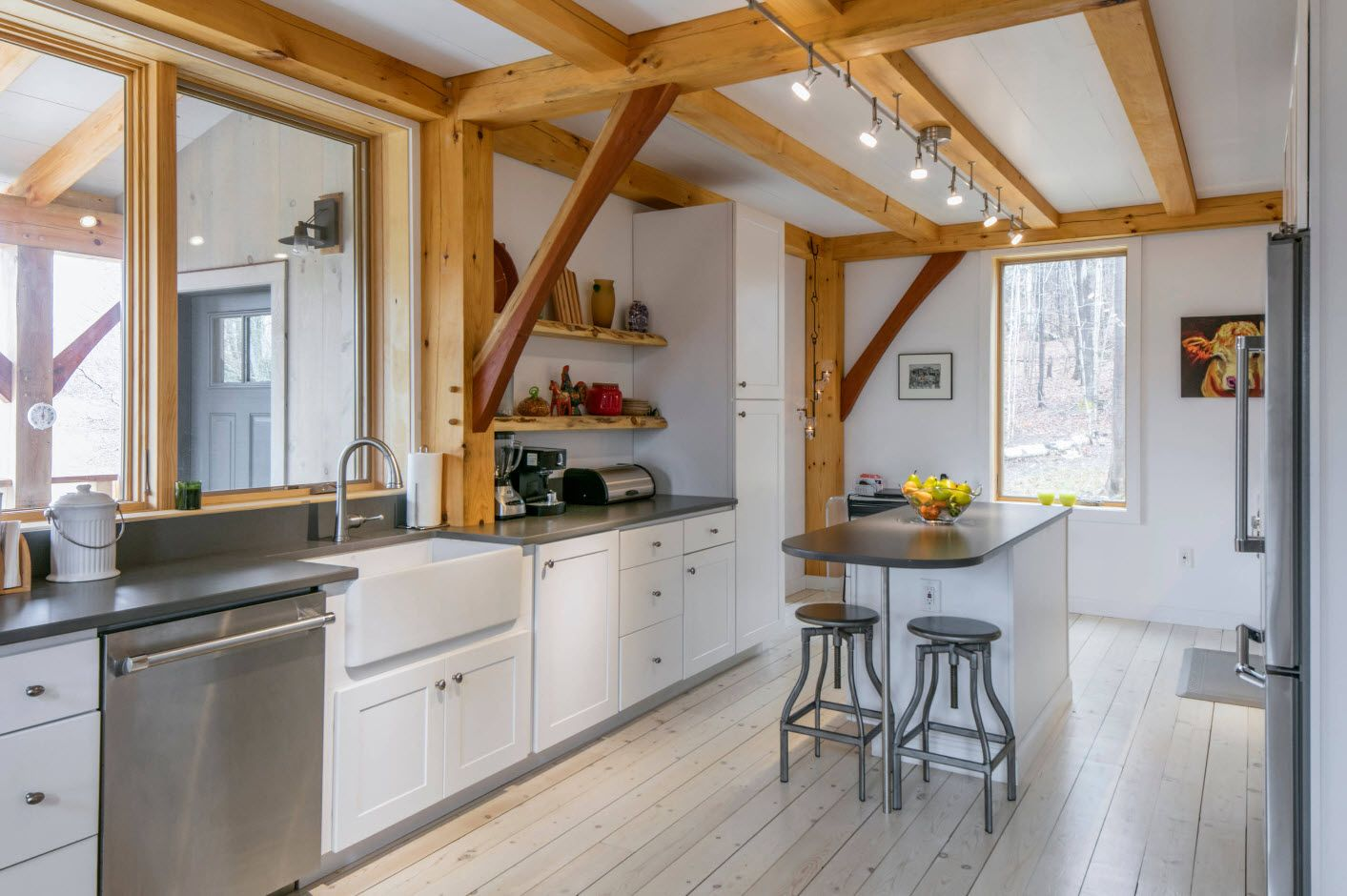 Modern Cottage Interior Design Tips. Trends and Features 2017. Wooden beams and frames at the spectacular Loft and Scandinavian style in the spacious kitchen
