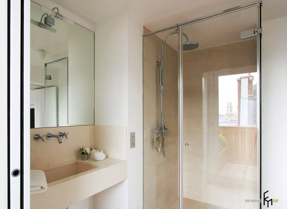 Bathroom with glass shower cabin and peach colored walls