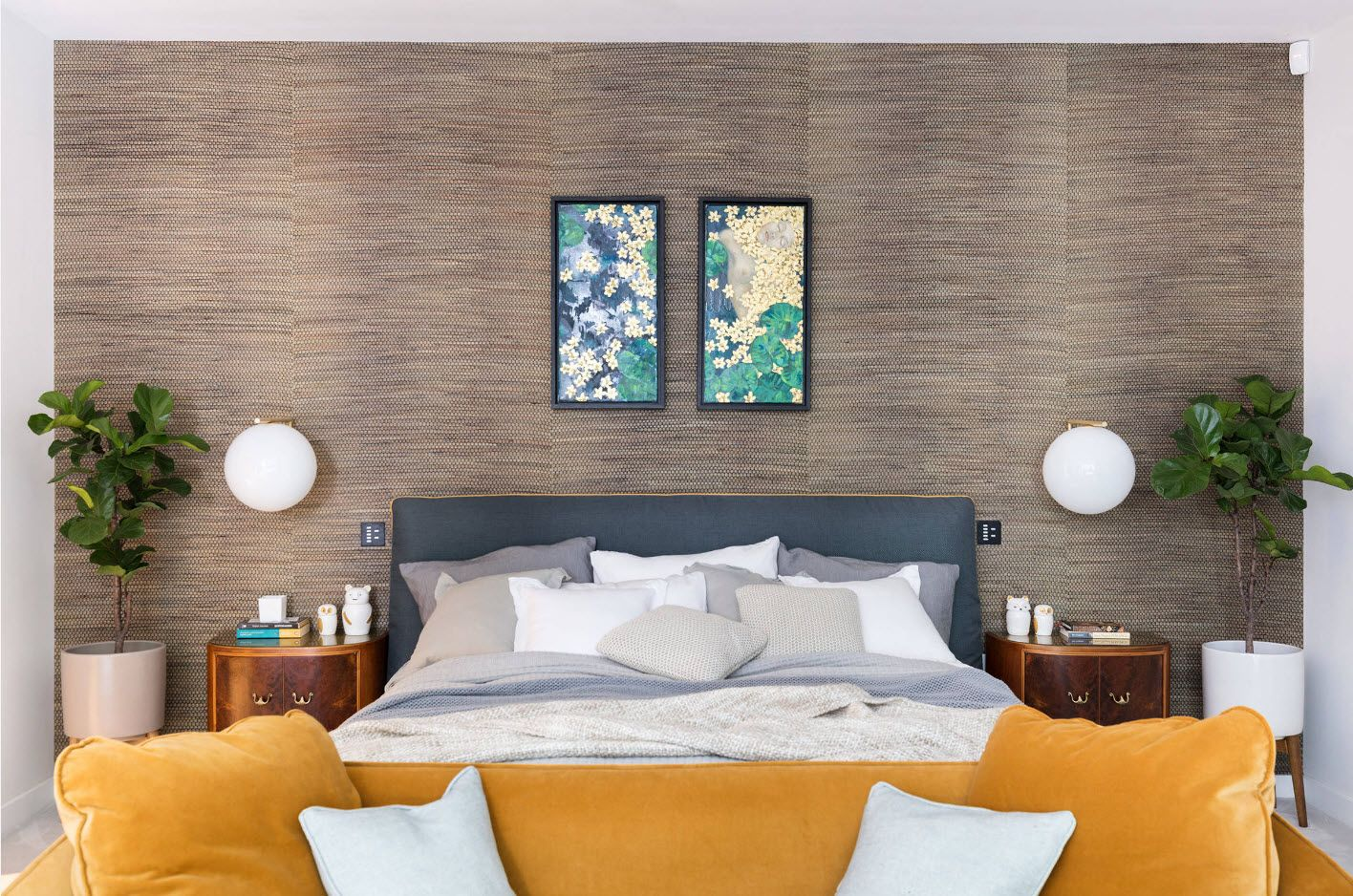 Accent texture wall at the headboard with sphere nightstands of the modern bedroom