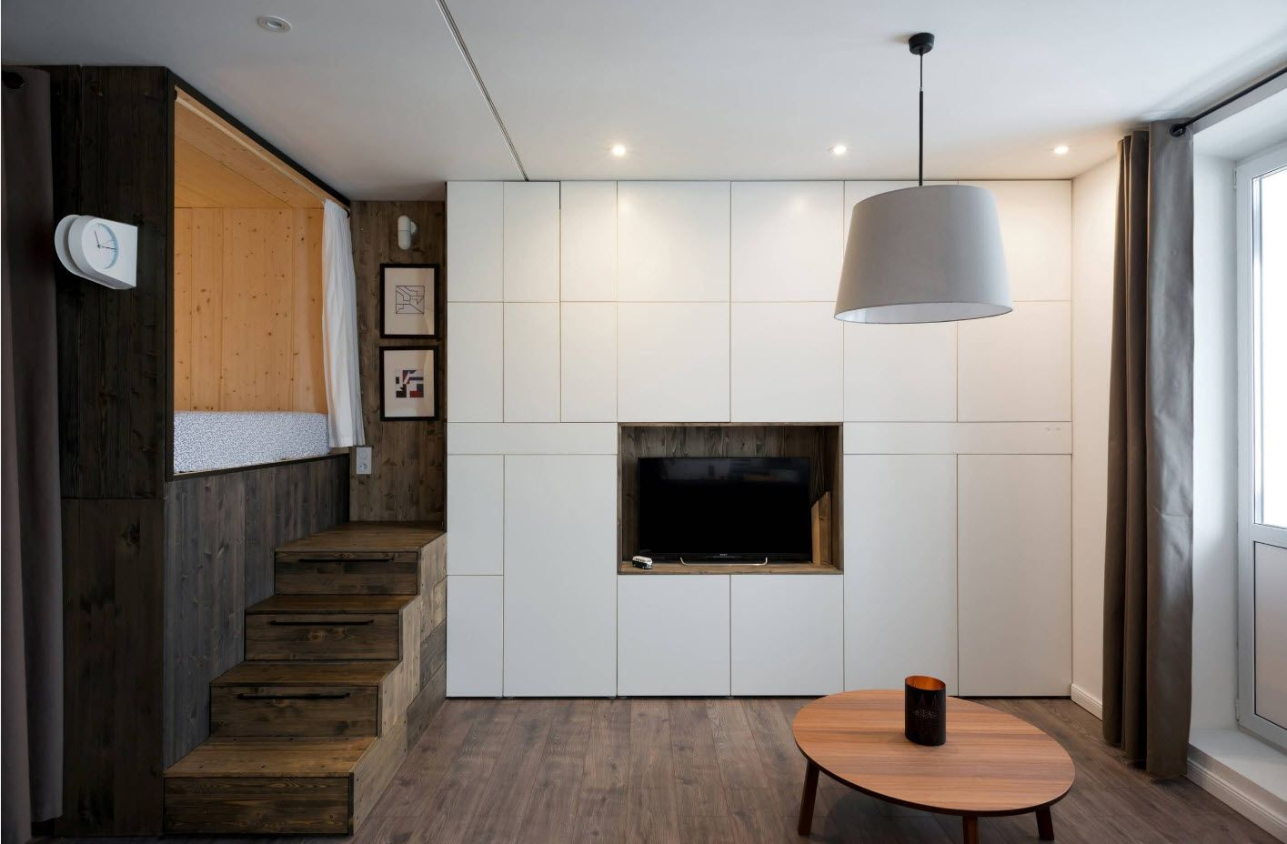 Modern Cottage Interior Design Tips. Trends and Features 2017. White accent wall with TV at the multifunctional space