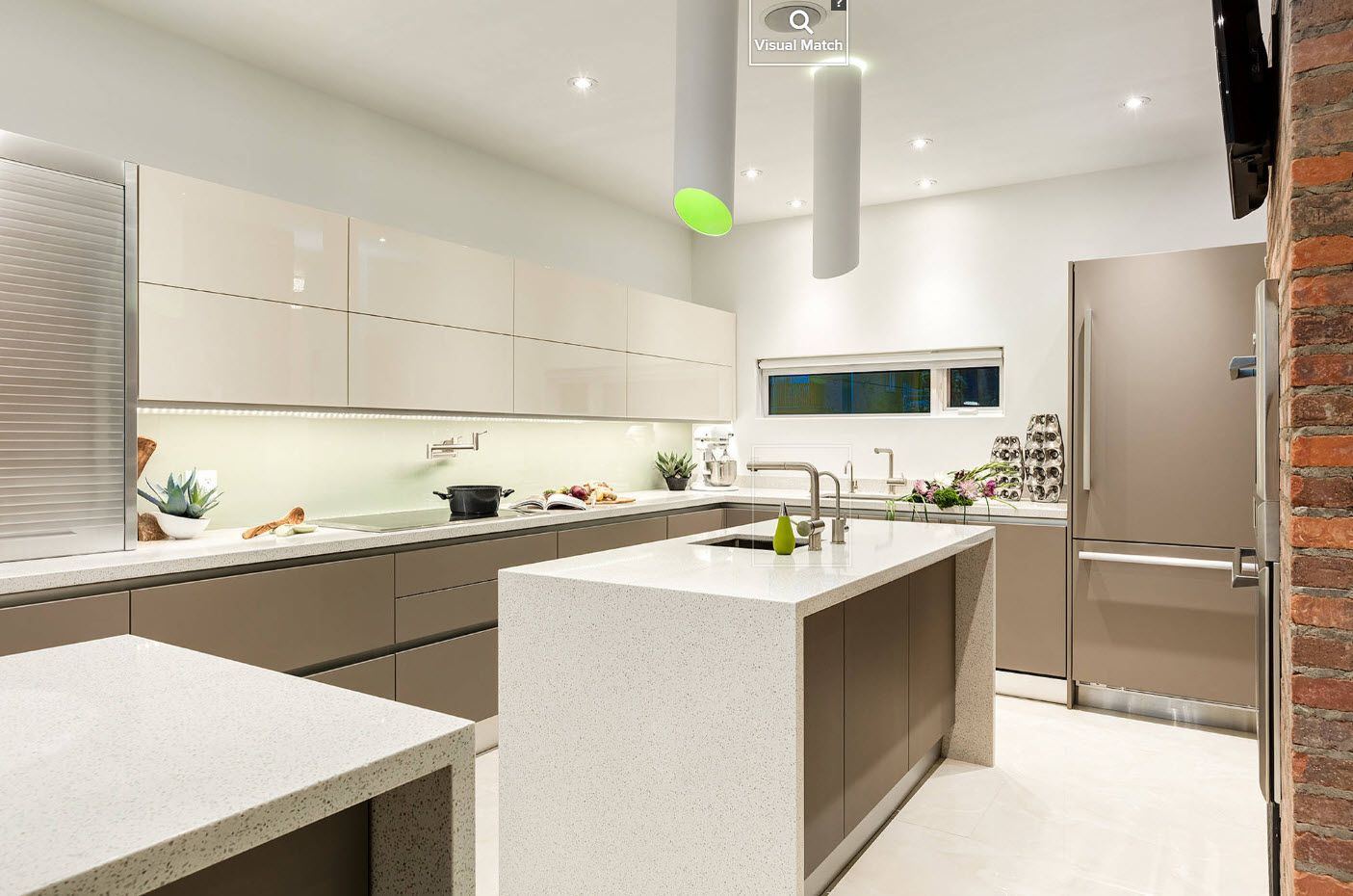Modern hi-tech interior in the kitchen with glossy plastic surfaces