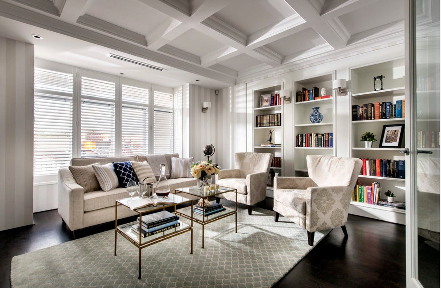 Wide and high spacious light-sinked living room in the studio apartment with reading zone