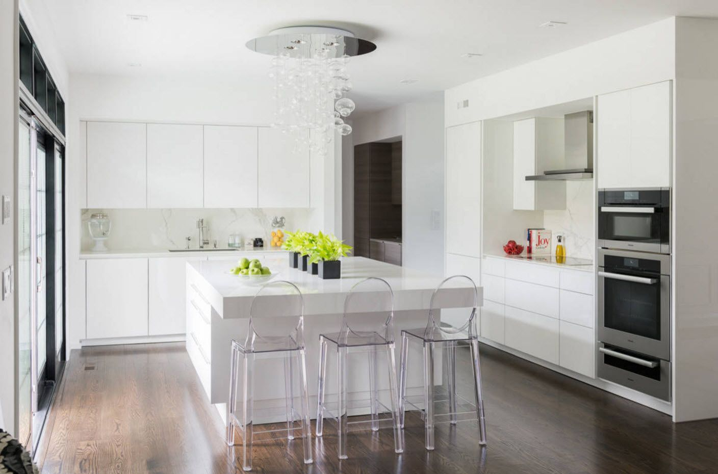 White kitchen interior with steel touch of lighting and chairs' carcases