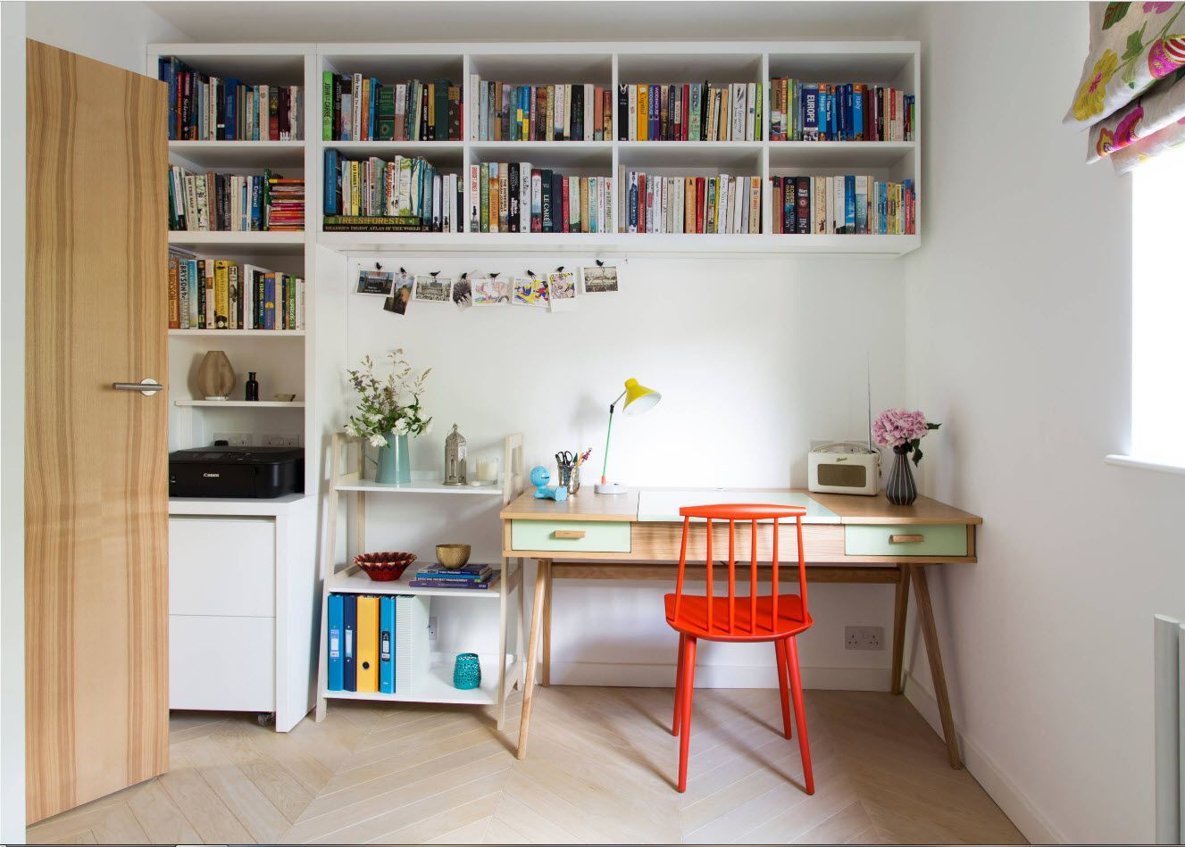 Top tier book shelves and the orange chair for the modern styled home office