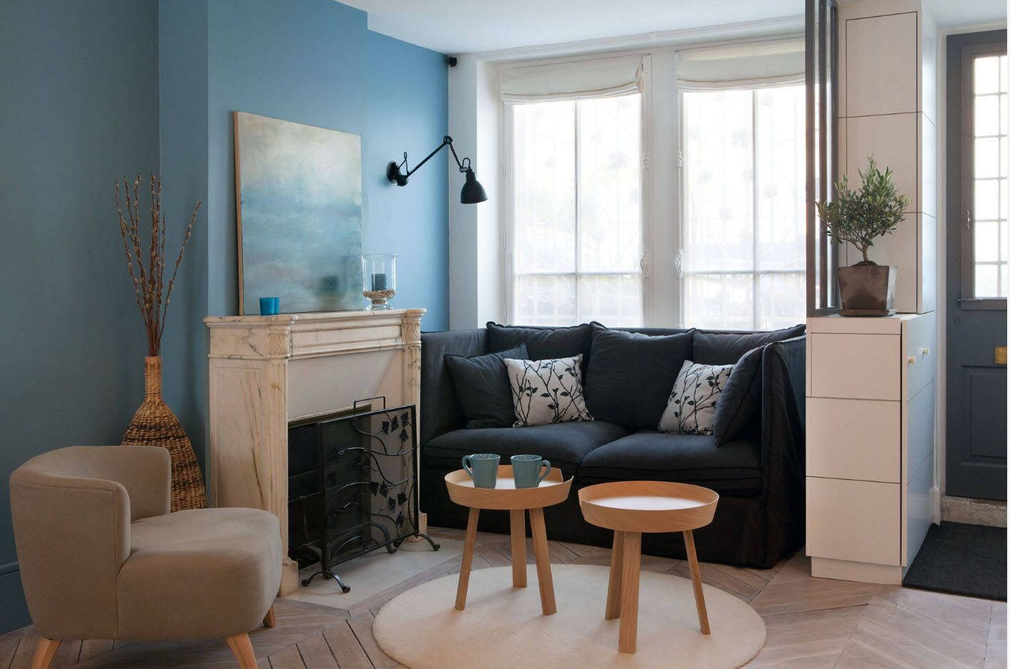 Modern design in the tight living room with blue painted walls