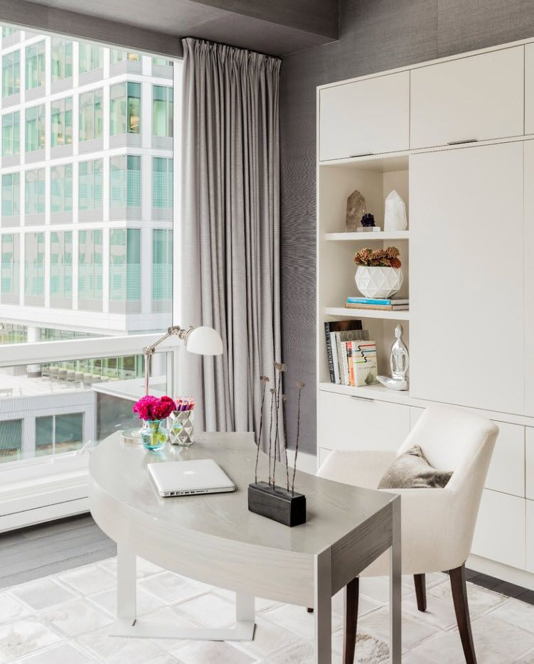 Gray drapes for working zone in the modern studio room with panoramic windows
