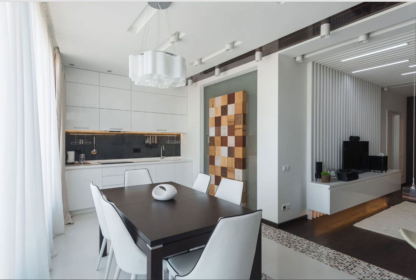 Nice mosaic kitchen accent wall and black table makes the interior the motley one