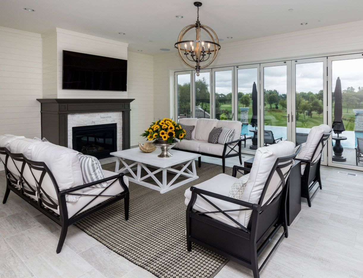 Dark framed wooden furniture with white upholstery at the living room