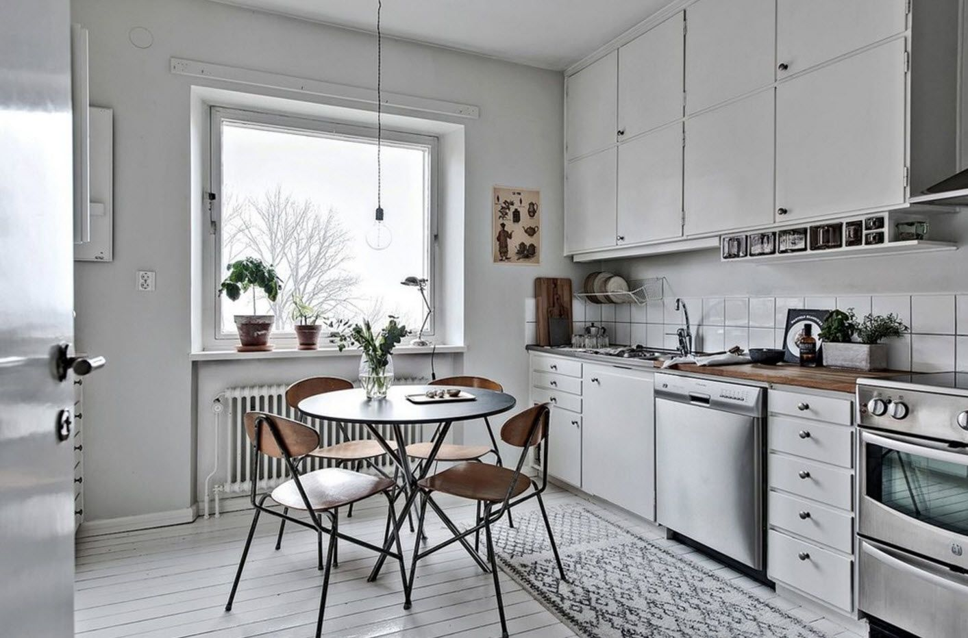 Scandinavian minimalism and suspended on black cord bulb with round table dining group