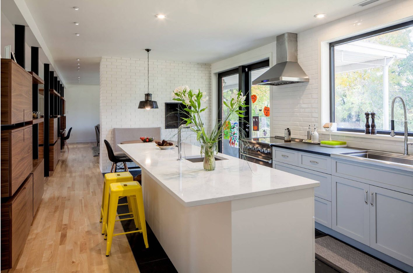 40 Square Feet Kitchen Modern Dedign Ideas & Layout Types. Row furniture plan and elongated island with yellow plastic chairs