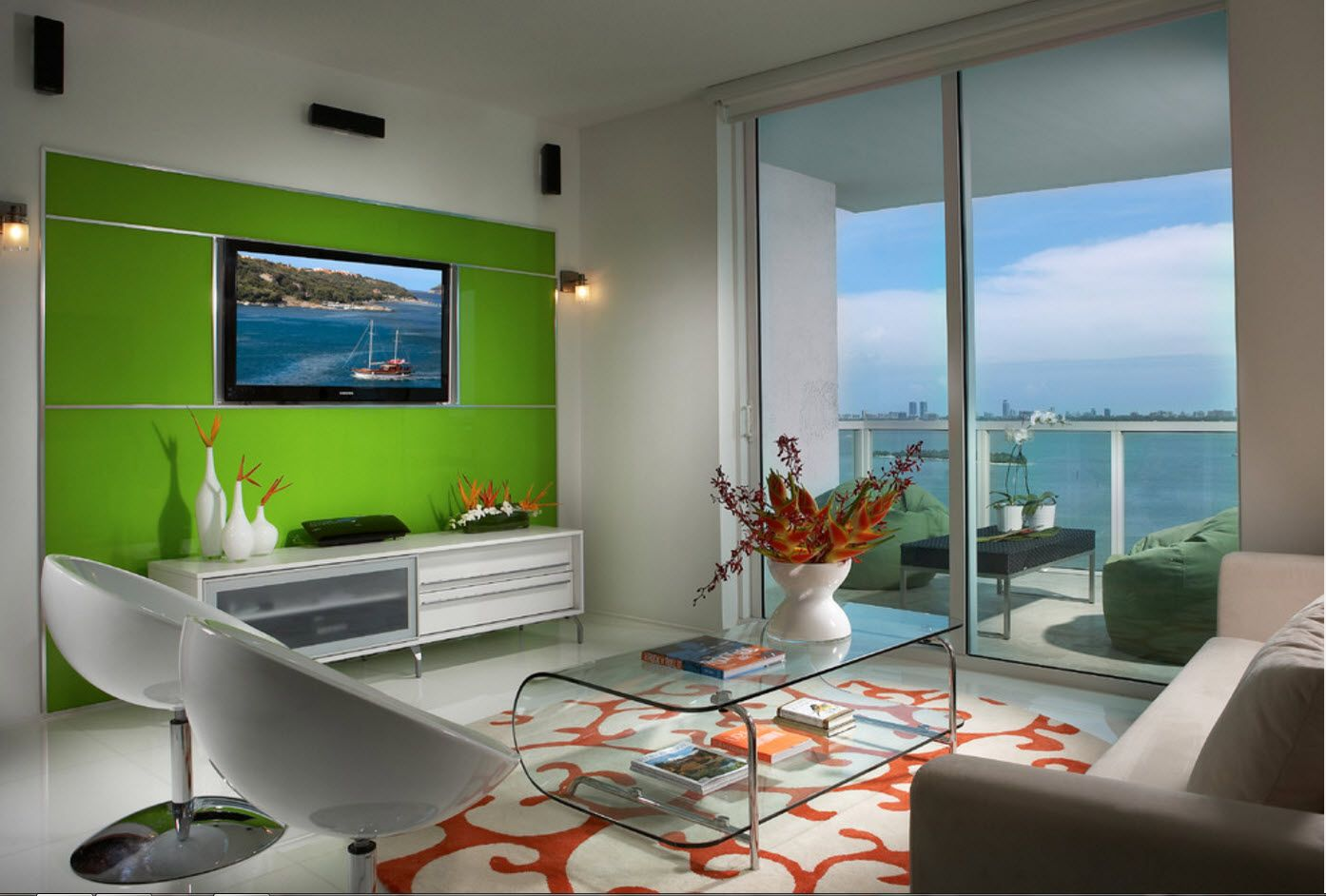 Green accent wall with modern LCD TV set