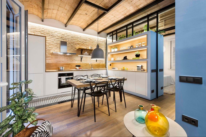 Loft kitchen design in the cottage interior of loft style
