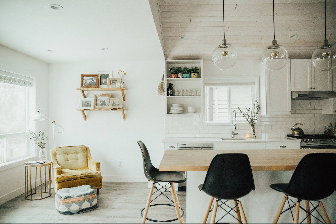 White rustic kitchen with black wooden chairs