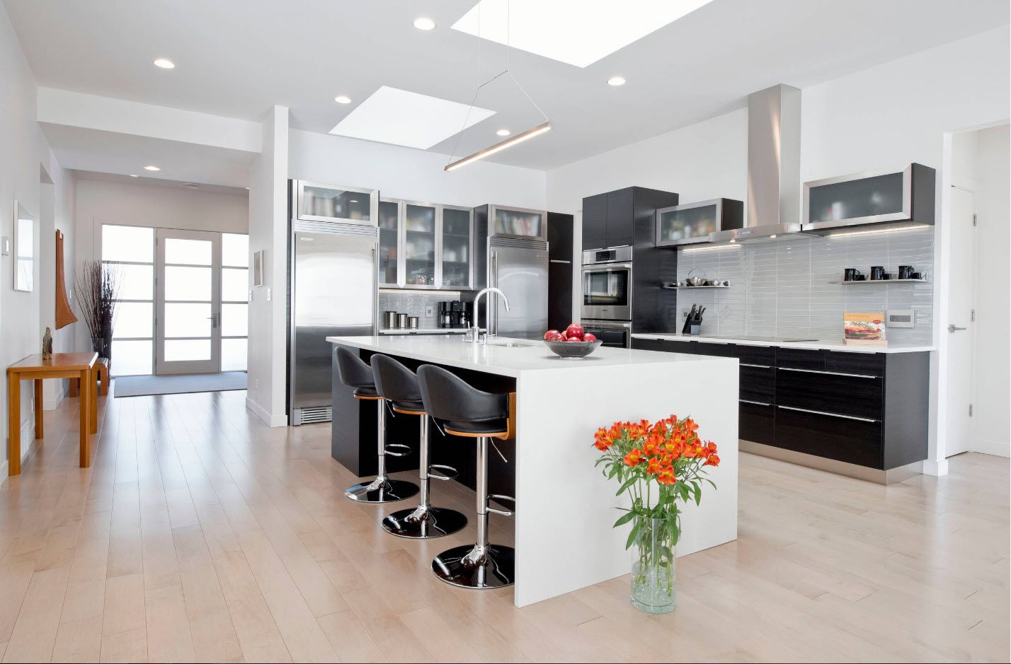 Classic styled Large kitchen with black bar chairs