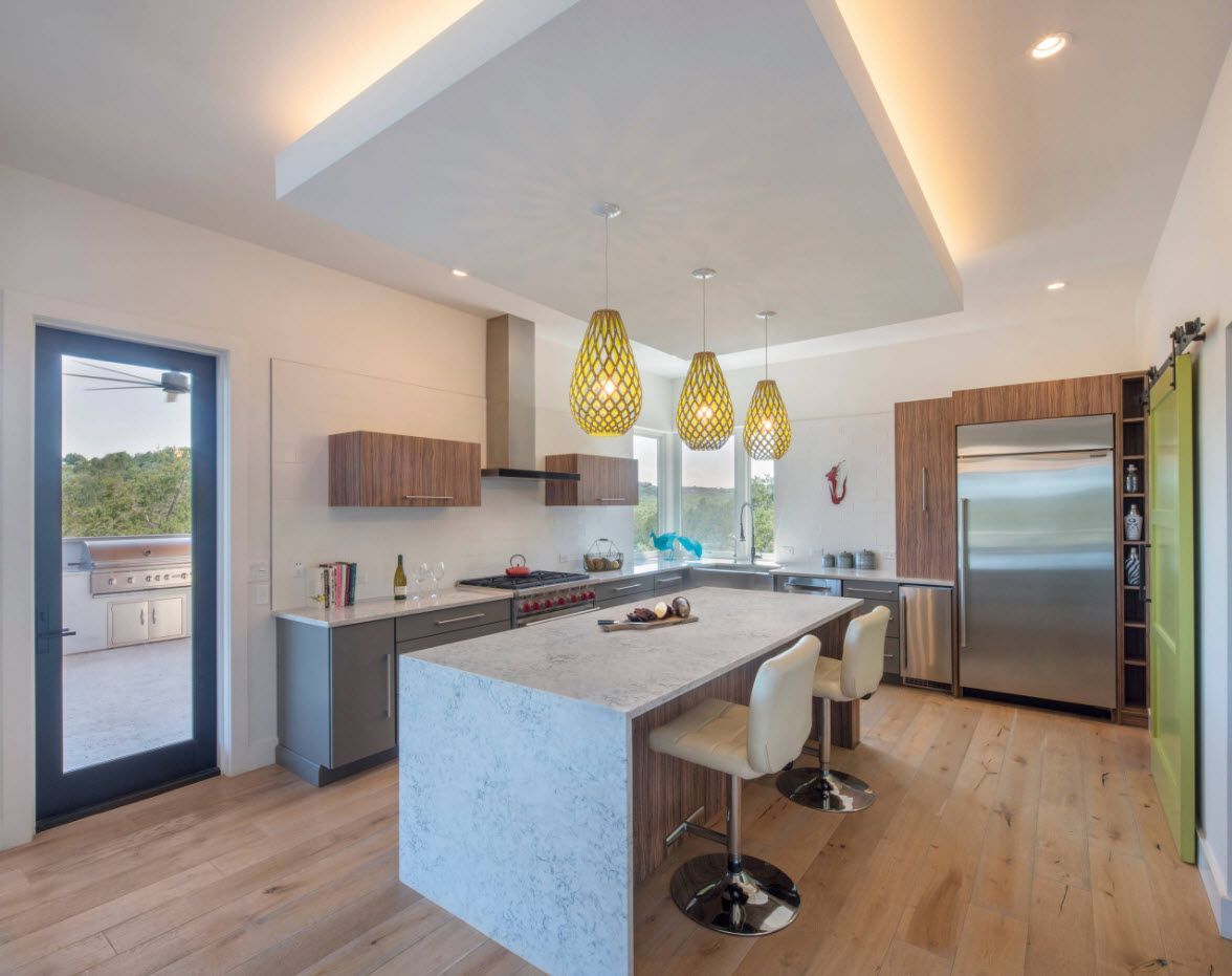 Nice island at the ceiling of the kitchen with backlight