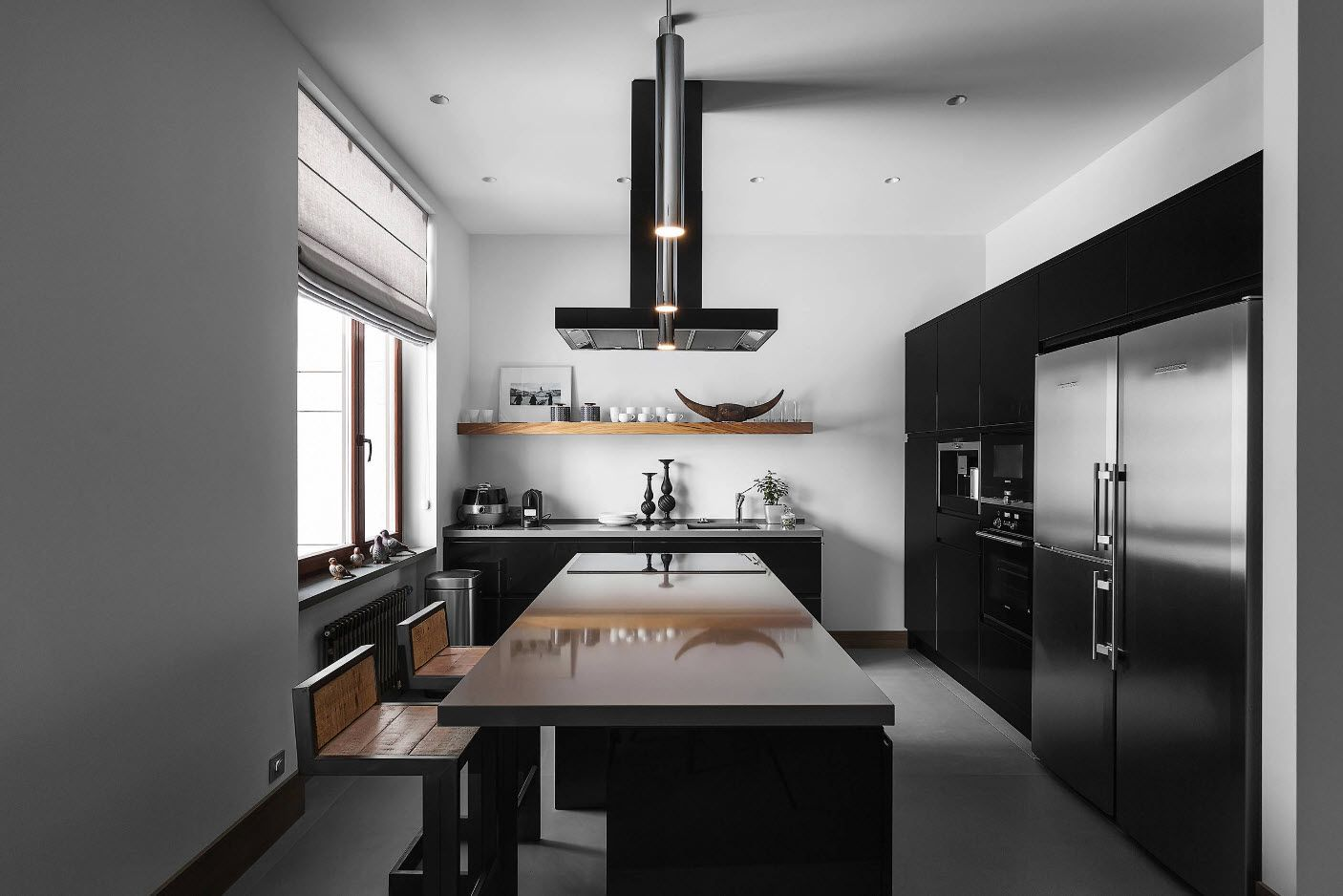 Central allocation of extractor hood in the modern hi-tech contrasting kitchen