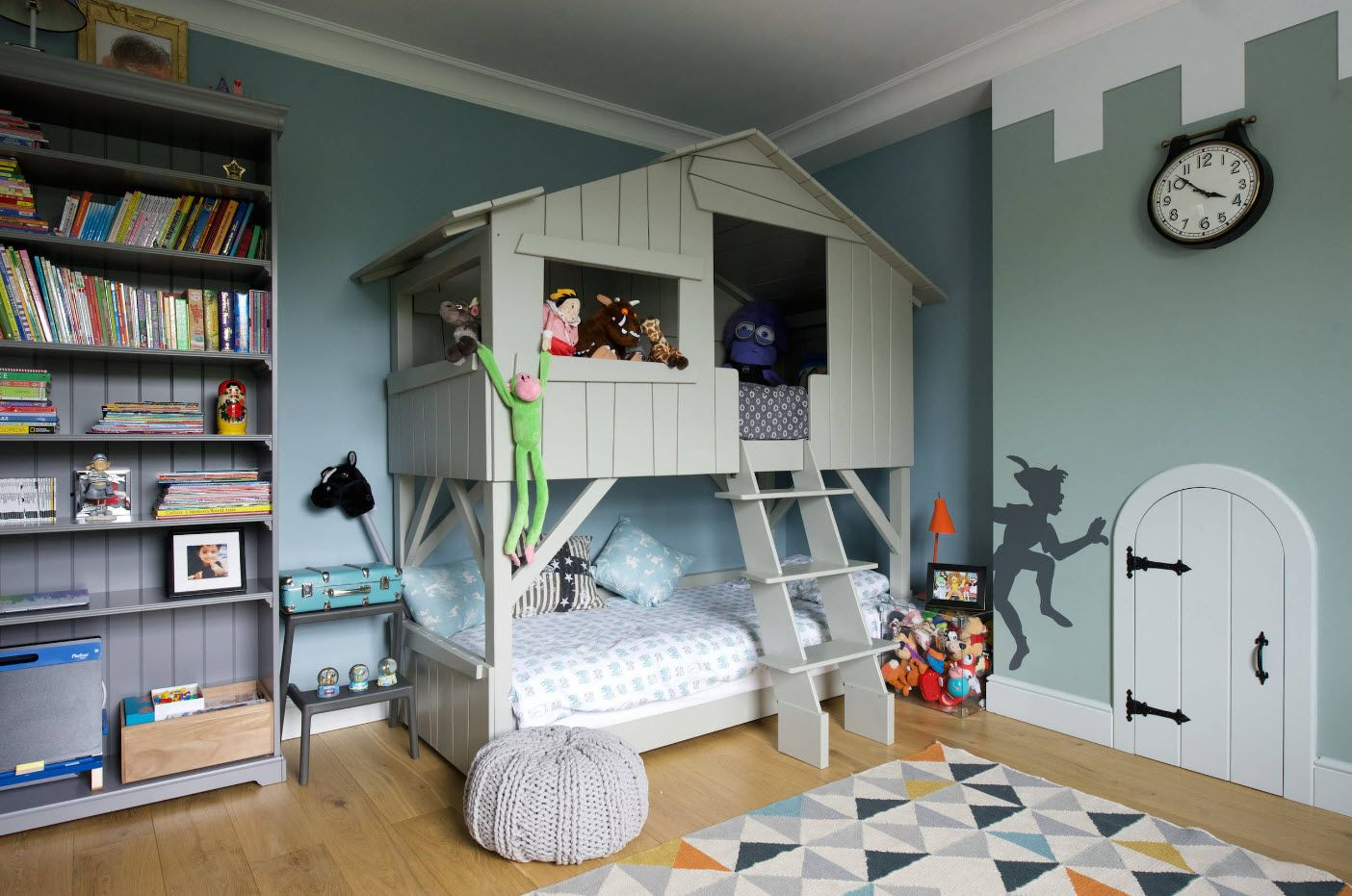 Children's room with spectacular kids' house as a bunk bed
