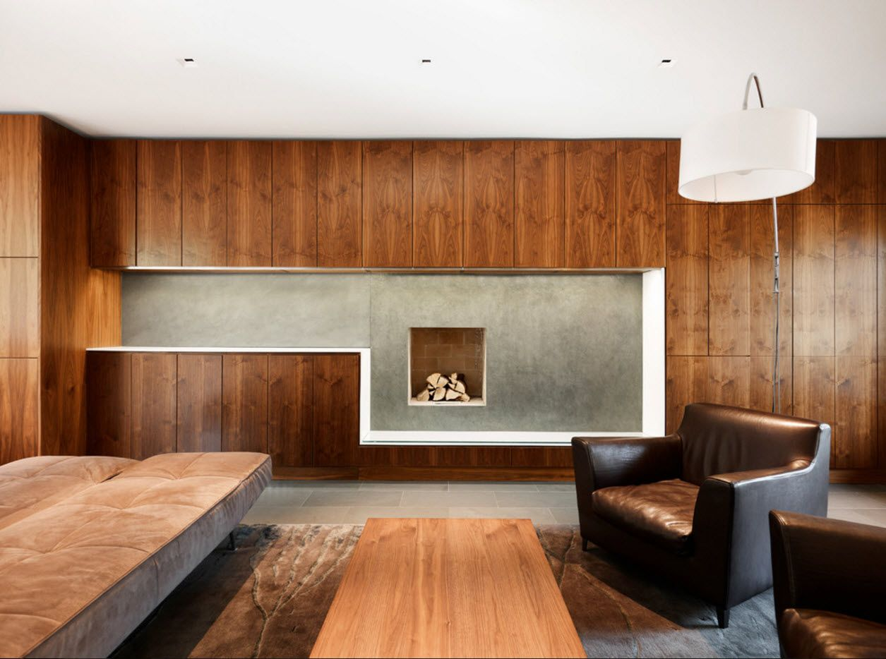 Unusual geometry of the wooden trimmed accent wall in the living