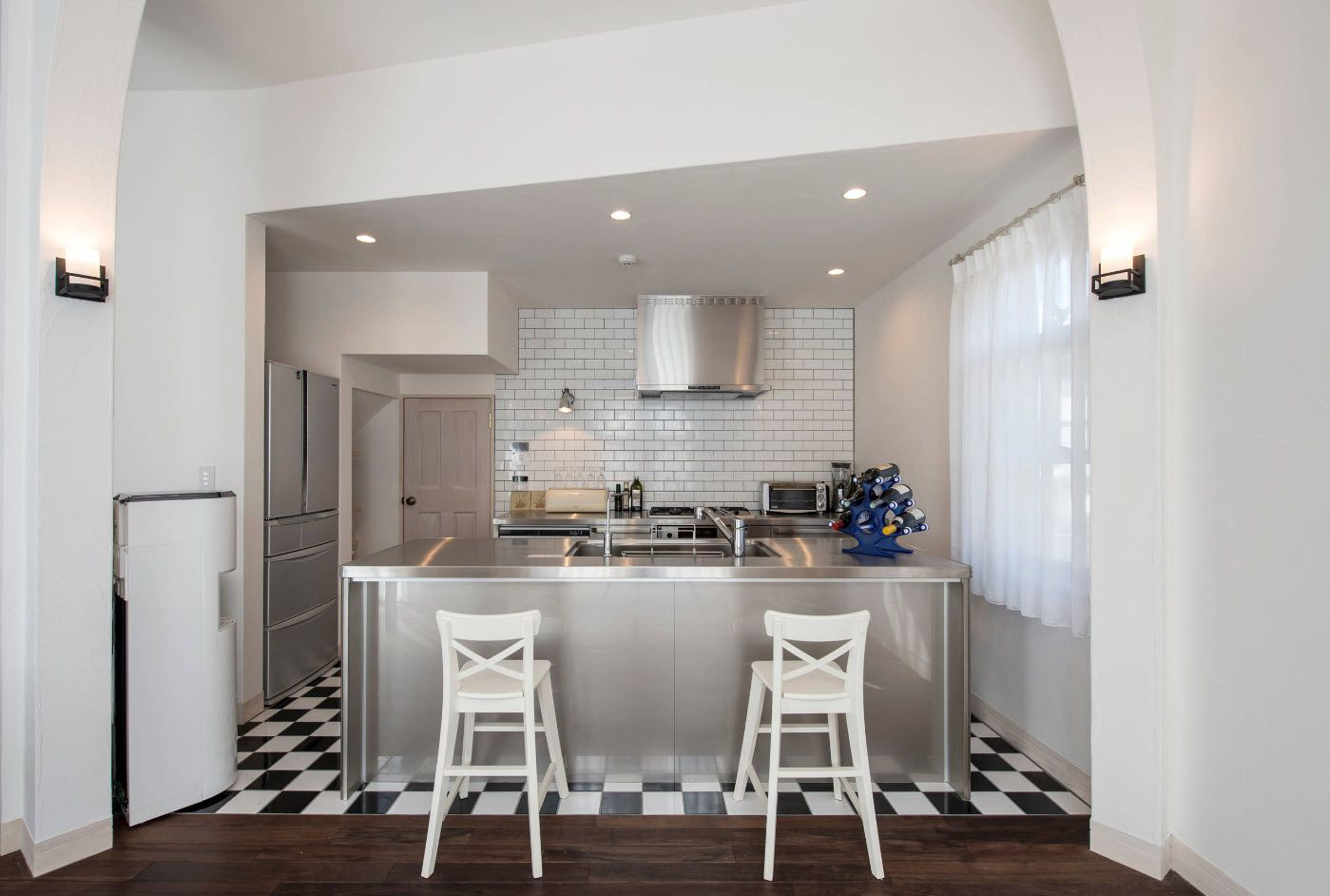 Chess tile florr and nice steel kitchen island