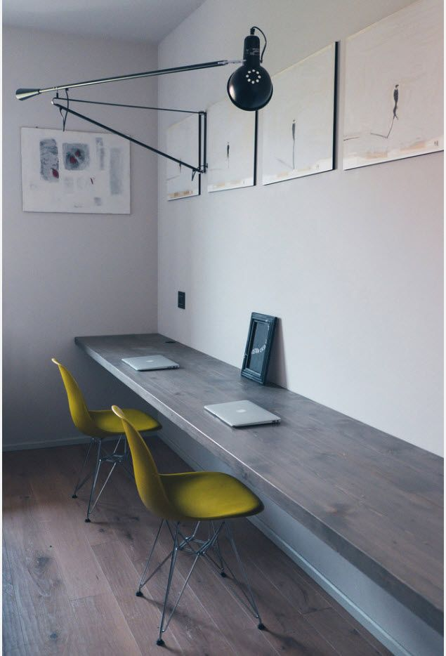 Wooden tabletop and yellow chairs in the home office for two